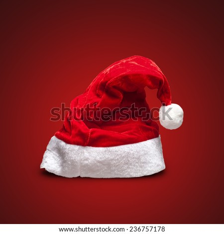 Single Santa Claus red hat on red background - stock photo