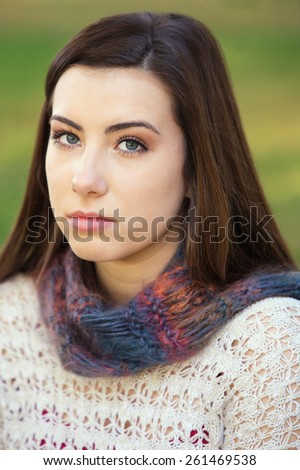 Single serious female teenager in sweater staring - stock photo