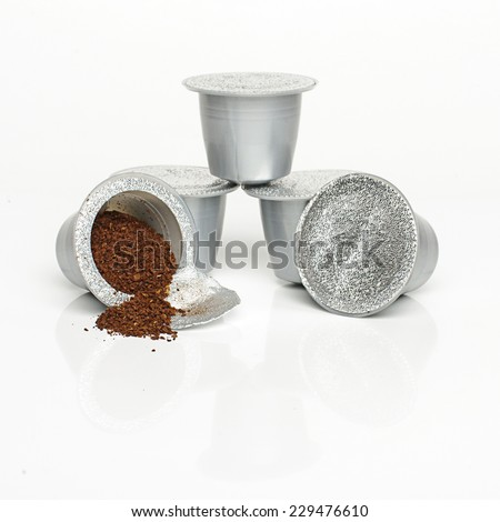 Single-serve coffee capsules isolated - stock photo
