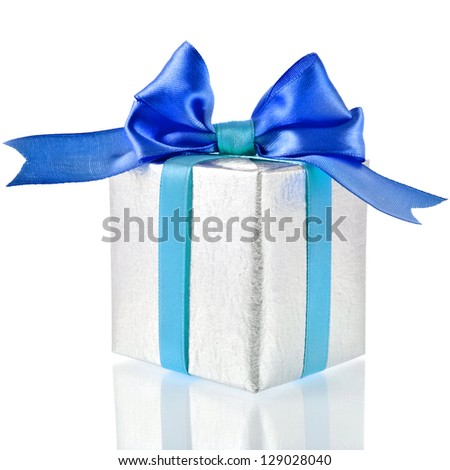 Single silver gift box with aqua-blue ribbon bow close up isolated on white background - stock photo