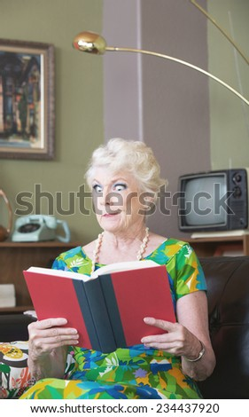 Single skeptical woman in green reading a book