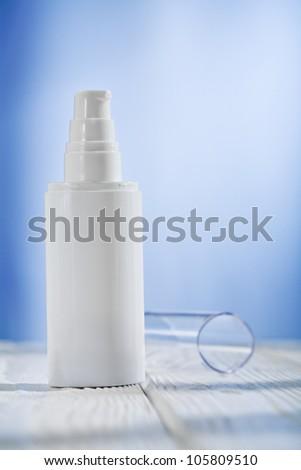 single skincare sprayer on white wooden table - stock photo