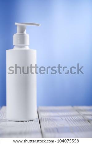 single skincare white sprayer on table - stock photo