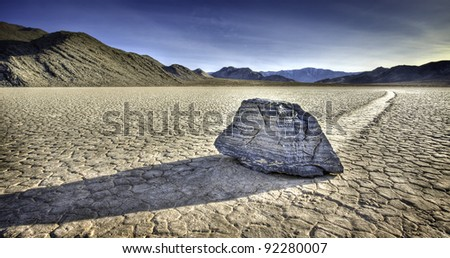Single sliding rock located on Racetrack Playa in a remote part of Death Valley National Park. - stock photo
