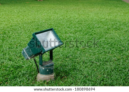 Single spot-light on green grasses. - stock photo
