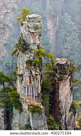 Single stone column mountain (Avatar rocks) in the mist. Zhangjiajie National Forest Park was officially recognized as a UNESCO World Heritage Site - China - stock photo