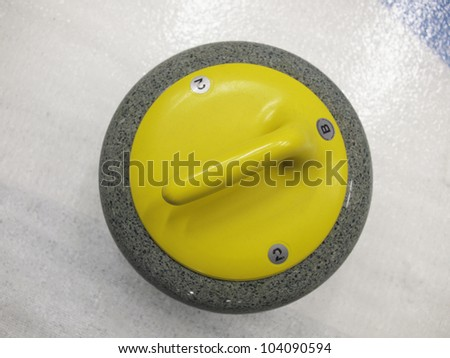 Single stone for game in curling on ice. - stock photo