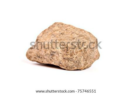 Single stone on a white background. - stock photo