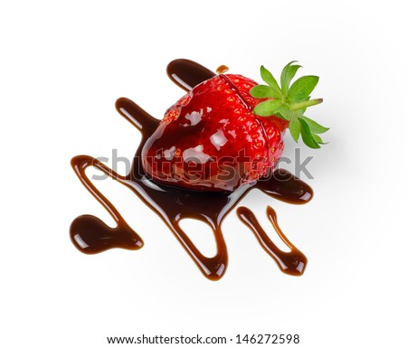 Single strawberry being drizzled with dark chocolate on a white background with clipping path