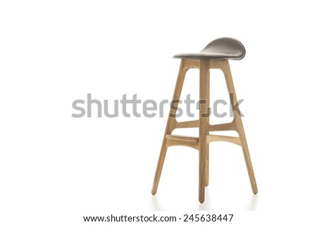 Single Tall Wooden Leg Stool Isolated on White Background. Emphasizing Copy Space.