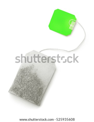 Single tea bag with green label isolated on white