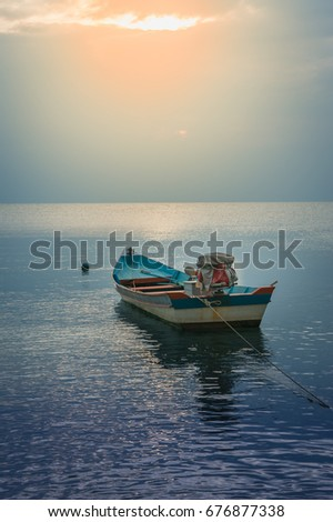 Single Thailand long tail boat in sunset