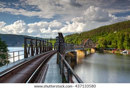 Single track railway bridge over the Vltava river, Czech Republic - stock photo
