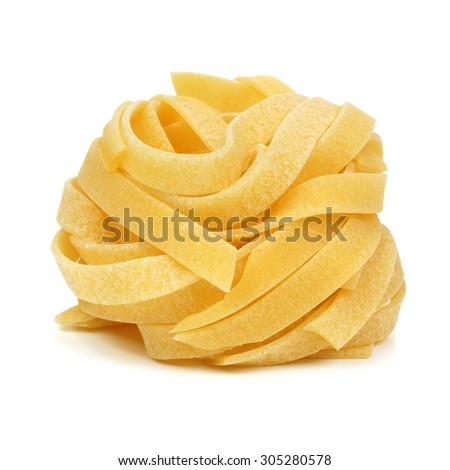 Single uncooked dry tagliatelle pasta nest isolated on a white background