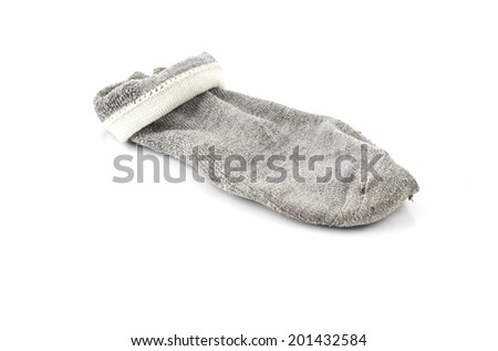 single used gray dirty sock isolated on white background