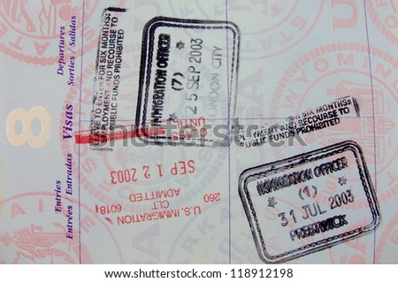 Single vivid passport page with five different stamps - stock photo