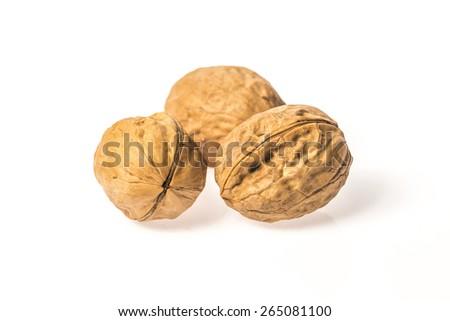 Single walnut isolated on a white background. - stock photo