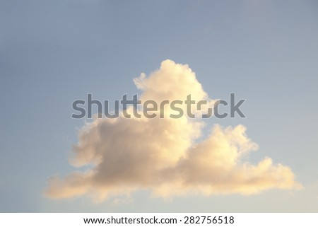 Single white Cumulus Cloud against blue Sky - Cumulus Clouds are commonly known as 'Fair-Weather Clouds' because they are associated with clear, fine Days.  - stock photo