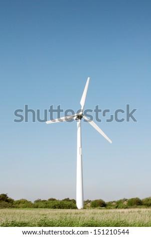 Single wind turbine - shot in Esbjerg Denmark - stock photo