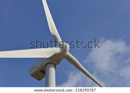 Single windmill for renewable electric energy production on blue sky