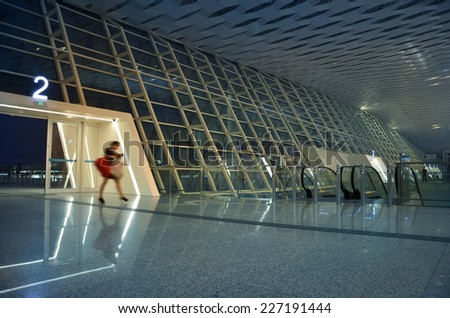 Single woman walking in the airport lobby  - stock photo