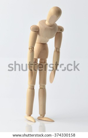 Single wooden dummy on white background
