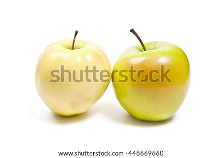 Single yellow apple and one green apple. Juicy ripe fruits. With clipping path. Isolated on white background. - stock photo