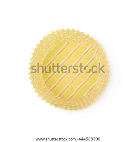 Single yellow paper cupcake cup isolated over the white background - stock photo