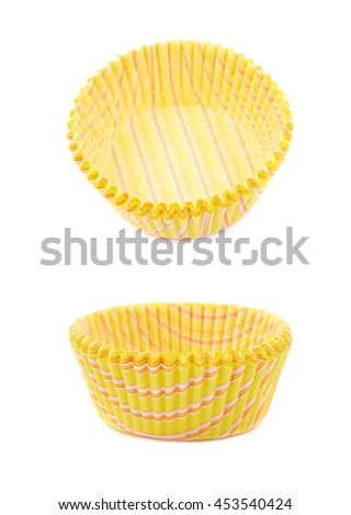 Single yellow paper cupcake cup isolated over the white background, set of two different foreshortenings
