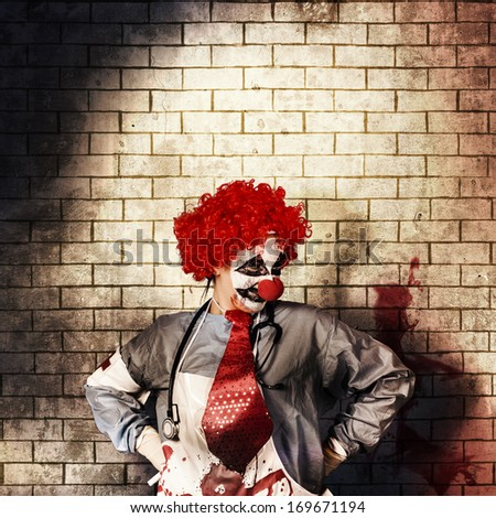 Sinister gothic hospital clown standing on grunge brick wall with masthead copy space. Psychopath surgeon  - stock photo