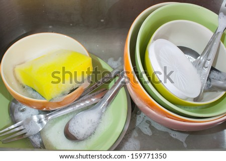 sink and dishes after dinner are waiting to watch - stock photo