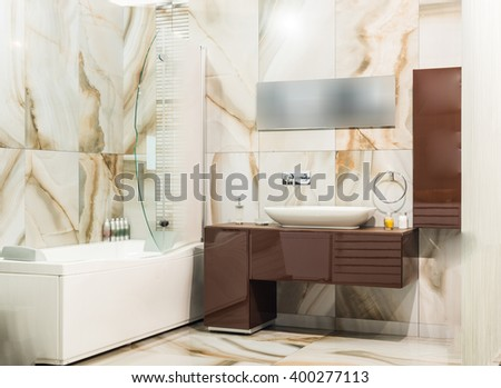 Sink and mirror in modern bathroom interiror
