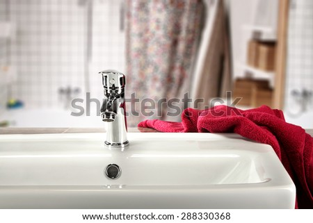 sink and red towel  - stock photo