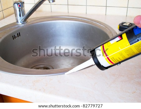 Sink and silicone sealant - stock photo