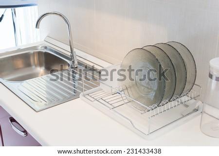 sink & dishes in modern kitchen - stock photo
