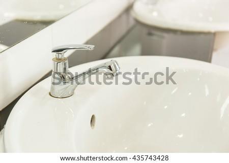 Sink in bathroom.Interior bathroom accessory. - stock photo