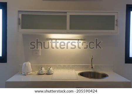 Sink in the kitchen is clean and tidy - stock photo