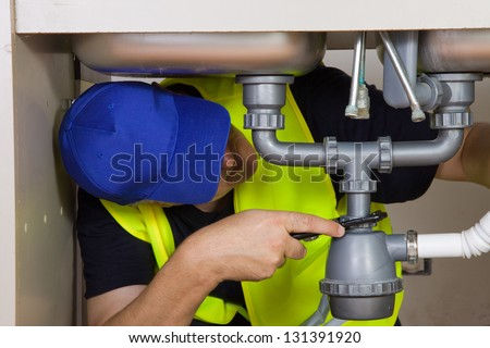 sink plumber - stock photo