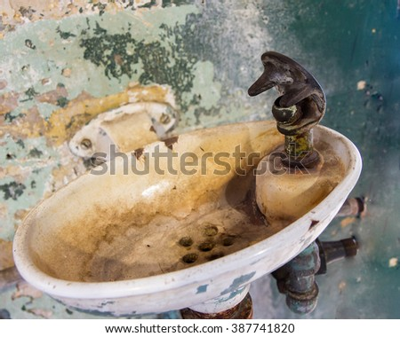 sink that is full of rust and other disgusting things. - stock photo