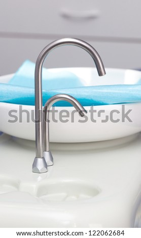 sink with a faucet in the dental office - stock photo