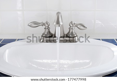 Sink with Running Water - stock photo