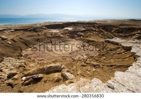 Sinkhole or open pit on the shore's of the dead sea at the end of the summer when the water level is at it's lowest  - stock photo
