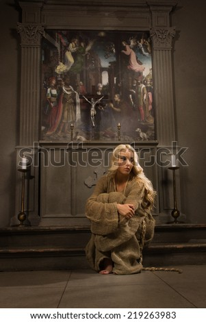 Sinner prays in medieval church