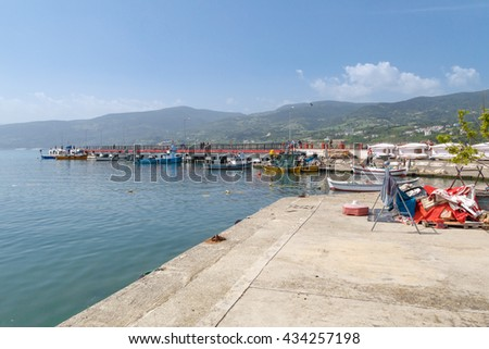 SINOP, TURKEY - MAY 14, 2016 : View of small fishing boats on coastline of Gerze Port in Sinop, on blue sky background. - stock photo