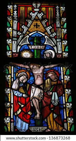 SINT TRUIDEN, BELGIUM - APRIL 21: Jesus on the cross on a stained glass window in the church of Our Lady in Saint Truiden on April 21, 2013, Belgium. - stock photo
