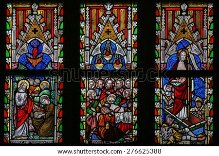 SINT-TRUIDEN, BELGIUM - APRIL 21, 2013: Stained glass window depicting Scenes in the Life of Jesus Christ in the Cathedral of Saint Truiden in Limburg, Belgium. - stock photo