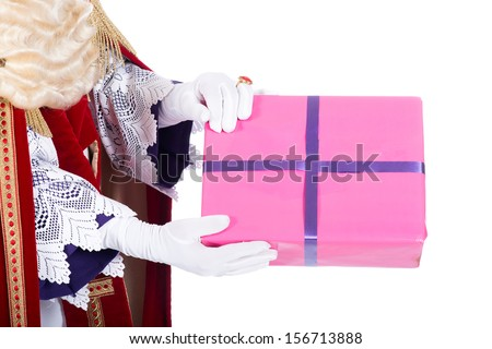 Sinterklaas giving a present to a child, on a white background - stock photo