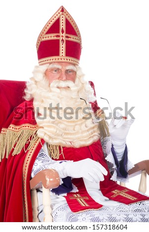 Sinterklaas is resting on his chair - stock photo