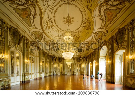 SINTRA, PORTUGAL - JULY 6: Symmetrical composition of rich decorated rooms in the Queluz National Palace , on July 6, 2014 in Sintra, Portugal. - stock photo