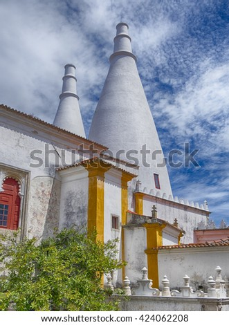 SINTRA, PORTUGAL - MAY 1, 2015: The two tall white chimneys of the National Palace of Portugal in Sintra are part of the historic landmark.